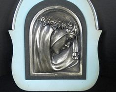 Art Deco Vintage wall plaque Madonna Mother Mary, silver metal embossed with pastel shade blue wooden back. Belgium 1920s.