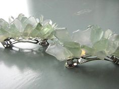 Sea glass hair barrettes are a simple way to adorn any bridal hairstyle. Non-beachy sea glass wedding inspiration.