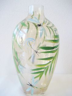 Handpainted glass vase with dragonflies and fern.