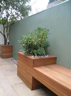 I love the way this sleek bench flows into and becomes a planter. The wall colour harmonises beautifully with the plants and other materials - restrained elegance at its best.