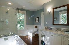 dark brown floor, white cabinets, light blue wall, dark accents (baskets), silver hardwar