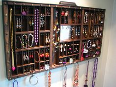 Mirrored printer drawer jewelry dispaly with side stud slots to allow for maximum storage as well as 2 ring cubbys.