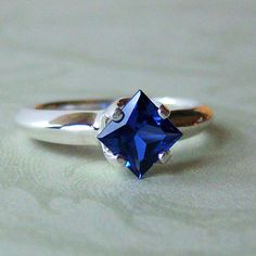 SALE 13ct Lab Blue Sapphire Argentium by cavaliercreations on Etsy, $54.00. This is exactly what I've always envisioned, just with a thinner band than I'd ideally like.  EPB