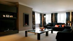 Modern luxury living room in black with dark brown furniture 20 Ways to Use Color Psychology in Your Home