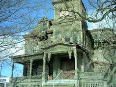 this old houses porch look like its going to bite of..... Yikes!