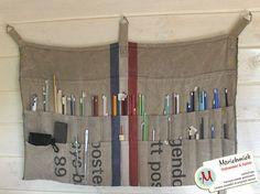 Hanging storage for knitting needles made from a Dutch postal bag(?) by Marieke van Esveld, via Flickr