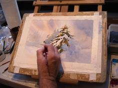 Artist Roland Lee demonstrates how to paint a snow scene in watercolor using negative painting technique