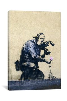Banksy Camera Man and Flower 18in x 12in Canvas Print