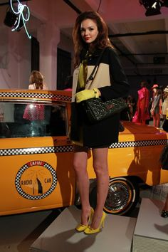 pops of yellow and emerald green at kate spade 2013