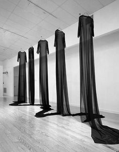 Mary Tuma's exhibition titled 'Homes for the Disembodied'. Five dresses made from 50 metres of continuous black silk, hung facing the same way. Visually beautiful of course, but it holds a much deeper meaning too; paying tribute to Palestinian women and their strength perceived as mere shadows during the war. The idea of empty dresses evoke a sense of loss or belonging.