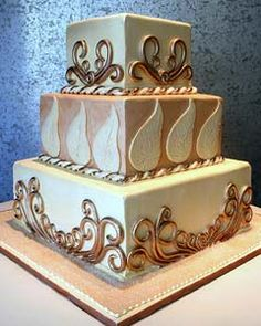 square wedding cake with scrollwork. www.rosebudcakes.com
