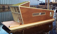Schwimmhaus: The Sustainable Modern HouseBoat  confused direction, schwimmhaus, boat house, sustainable house boat, green roof house boat, green architecture, green building