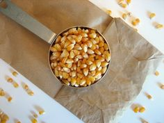 Microwave Popcorn in a Paper Bag: 1/2 cup kernels.  Easy.