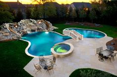 Love this pool and hot tub.  check out the bridge and the slides