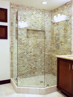 """Like the tile and stone floor.  Called """"rustic contemporary""""  http://www.hgtv.com/designers-portfolio/room/contemporary/bathrooms/4428/index.html#/id-3993/room-bathrooms"""