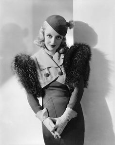 """Bette Davis, """"Fashions of 1934"""" (1934). Gowns by Orry-Kelly."""