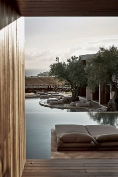 Greek landscape informs natural-toned suites of the Olea Hotel