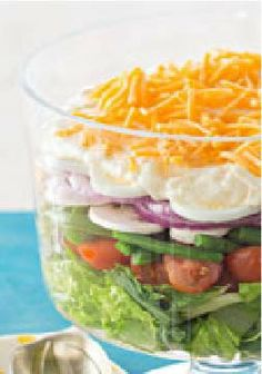 Lovely Layered Salad – All of your favorite salad topping favorites layered into one delicious party recipe.