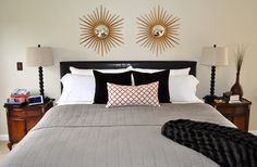 Neutral bedroom with brown, gray and orange color scheme.