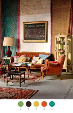 Exotic Buenos Aires studio: love the combination of antique furniture with worldly decor. Also love the colors: rustic orange, mustard and teal, for a stunning fall palette. The patchwork wall was made with paper—impressive use of pattern and texture! Click through if you want to copy the style of this interior designer!