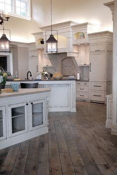 white cabinets, rustic floor, lanterns @ Home Design Ideas