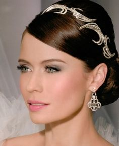 "Ornate Rhinestone Hair Combs Looking to be bridal royalty on your wedding day? A veil paired with a tiara says ""bride"" more than any other bridal accessory. Capture your bridal style with one-of-a-kind pieces by Bel Aire Bridal, a top manufacturer of veils and headpieces for the past 26 years."