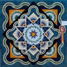 Glacier Star, designed by Quiltworx.com, made by Ann Sabatini.  Quilt was made in a workshop with CI, Jackie Kunkel and is a best of show wi...