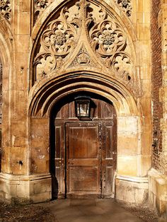 Door to Trinity College, Cambridge , England, UK. Trinity College was founded by Henry VIII in 1546 as part of the University of Cambridge.