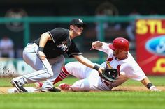 Matt Adams steals second base against Ed Lucas of the Miami Marlins in the fourth inning. Cards lost 8-4. 7-06-14