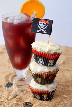 Drunken Sailor Rum Cupcakes with Pineapple Frosting and a Rum Runner cocktail