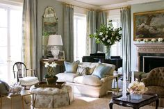 Soft blues and creams create a serene mood in this elegant living room