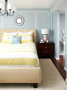 """Love the """"his"""" and """"hers"""" pillows.  Cute idea.  Also love the color of the blue walls and overall feel of this room."""