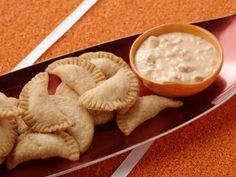 Cheesiest Fried Chicken Empanadas with Chili Con Queso Dip from FoodNetwork.com