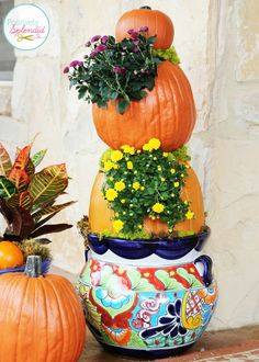 Pumpkins and mums are standard supplies for any fall decor. But we bet you've never seen them utilized quite like this! Let blogger Amy from Positively Splendid show you how to create a stacked pumpkin planter. || @splendidamy