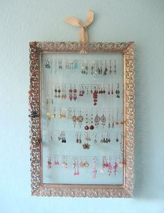 Cute ideas for jewelry displays!  I like the tray, the branch and the repurposed frames!