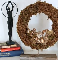 Dollar Store mushroom & moss wreath. Would look nice as a Thanksgiving decoration, I think.