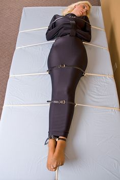 Strapped on a Bed in Spandex Straitjacket Bag & Nylons