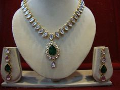 DIAMOND STRING EMERALD SET -   Zircon and Emerald studded Necklace Set with Matching Earrings. Price -  $59.00. Description -   String styled zircon studded necklace set with artificial emerald pendent and a pair of matching earrings styled with an emerald drop. #Jewelry