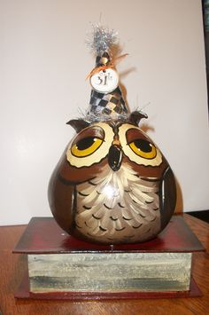 Gourd Owl on a paper mache book. Handpainted and crafted in Ohio