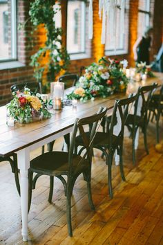 tablescape with greenery, photo by Angela Cox Photography http://ruffledblog.com/notwedding-greenville #weddingreception #tablescapes