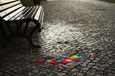 Yarn bombed cobblestones. Color amidst all the grey.