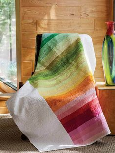 Modern quilt darling Heather Jones infuses winter days with all the colors of the rainbow. Easy strip piecing creates a modern marvel.