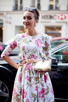 STREET STYLE SPRING 2013: PARIS FASHION WEEK - A pretty floral amongst all that black.