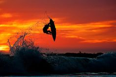 Surfer Nate Tyler airborne against a Central #California sunset. Photo by Chris Burkard