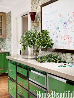 green cabinetry, art, fun