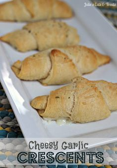 Cheesy Garlic Crescents ~ Buttery Crescents stuffed with cheese and brushed with garlic butter via www.julieseatsandtreats.com