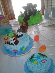 Noah's Ark cake for my daughters baby shower. Note how the first cake is all water, the second has a little land left and the third is on dry land.