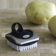 I love the Chef'n Stainless-Steel Palm Veggie Brush on Williams-Sonoma.com