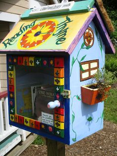 """Christine Browning. Tolland, CT. Our """"Reading Thyme"""" whimsical library has a living roof-various thyme plants-and window boxes. It houses a seed packet and healthy recipe exchange, along with books for people of all ages. Visitors are also encouraged to write in our garden journal about their visit to the garden-what books were brought or exchanged, wildlife observed, new neighbors met, interesting recipes discovered, seeds shared, and monarch butterflies watched."""