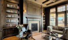 Library: This is one of my favorite rooms I designed. The walls are actually painted with a glaze, not stained. Came out looking amazing, don't ya think?